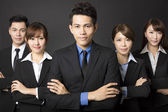 Young businessman with successful business team — Stock Photo