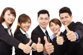 Smiling business people with thumbs up — Stock Photo