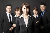 Young businesswoman with successful business team — Stock Photo