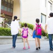 Father and mother Walking To School With Children — Stock Photo #80105102