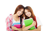 Two  happy teenage students girls isolated on white — Stock Photo