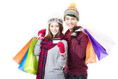 Happy couple shopping together with winter wear — Stock Photo