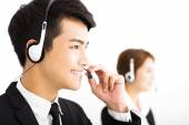 Young business people working with headset in office — Stock Photo