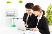 Happy business man and woman working  in office — Stock Photo
