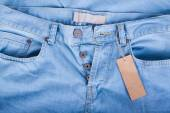 Blue jeans detail with blank label — Stock Photo