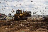 Landfill rubbish bulldozers processing garbage — Stock Photo