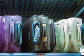 Suitcases on the shelf in the store — Stock Photo