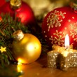 Christmas card with golden candle, balls, pine tree, lights and — Stock Photo #51887505