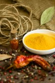 Turmeric in saucer with spices — Stock Photo
