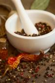 Mortar & pestle with pepper and chili — Stock Photo