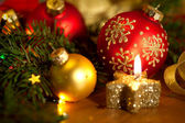 Christmas card with golden candle, balls, pine tree,  lights and — Stock Photo