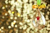 Christmas magic light background with glass bauble and colorful  — Stock Photo