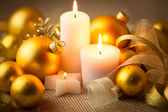 Christmas candles background with glitter and baubles — Stock Photo