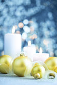 Christmas light blue background  with candles and baubles — Stock Photo