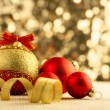 Christmas Bright red baubles with golden ribbons  — Stock Photo #53353783