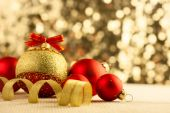 Christmas Bright red baubles with golden ribbons  — Stockfoto