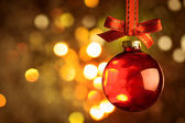 Christmas red bauble over magic bokeh  background  — Stock Photo