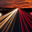 Speed Traffic - light trails on motorway highway at night — Stock Photo #53362879