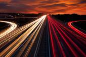 Speed Traffic - light trails on motorway highway at night — Stock Photo