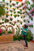 Woman is watering the flowers on  wall, Cordoba Patio Fest, Spa — Stock Photo