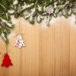Christmas background with firtree, decorative trees and cones on — Stock Photo #53874339