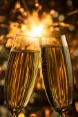 Beautiful golden champagne with sparklers - vertical — ストック写真