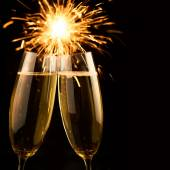 Beautiful golden champagne with sparklers - black square  — Stock Photo