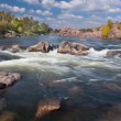 Beautiful sunny Autumn Day on The River with waterfall and big r — Stock Photo #54390453