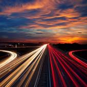 Speed Traffic at Dramatic Sundown Time - light trails  — Stock Photo