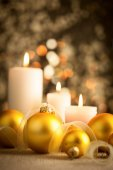 Christmas  background with golden boubles and candles — Stock Photo