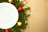 Christmas white plate with firtree on wooden background — Foto Stock