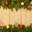 Christmas background with firtree, candies and baubles — Stok fotoğraf #56736165