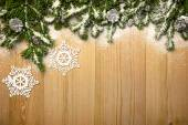 Christmas background with firtree, decorative snowlakes and cone — Stock Photo