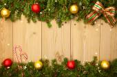 Christmas background with firtree, candies and baubles — Stock Photo