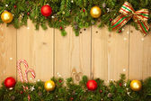 Christmas background with firtree, candies and baubles  — Стоковое фото