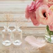 Vintage Still life with pink flowers in a vase with fearher and  — Stock Photo