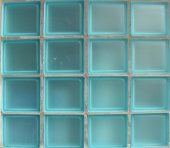 Square glass tiles from window in bright blue — Stock Photo