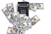 Simple calculator and money — Stock Photo
