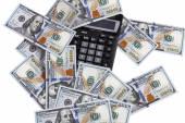 Pocket digital calculator and dollars — Stock Photo