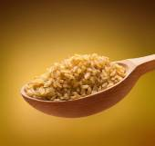 Bulgur in a wooden spoon — Stock Photo