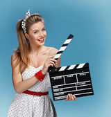 Sexy pin-up girl holding a Clapper board. Filmmaking or film production concept — Stock Photo