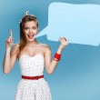 Young talkative woman showing sign speech bubble banner looking happy excited — Stock Photo #65891035