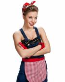 Sexy maid wearing apron with arms across — Stock Photo