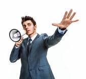 Young man shouting through a megaphone — Stock Photo