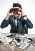 Guy spying with binoculars — Stock Photo