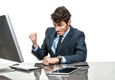 Cheerful manager is satisfied with his profit, income, earnings, gain, benefit, margin — Stock Photo