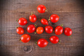 Tomatoes on wooden table. — Stock Photo