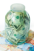 Dollars in the glass jar isolated on white background — Stock Photo