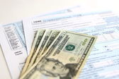 USA Tax Form 1040 with 20 US dollar bills — Stock Photo