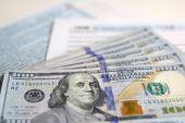 USA Tax Form 1040 with new 100 US dollar bills — Stock Photo